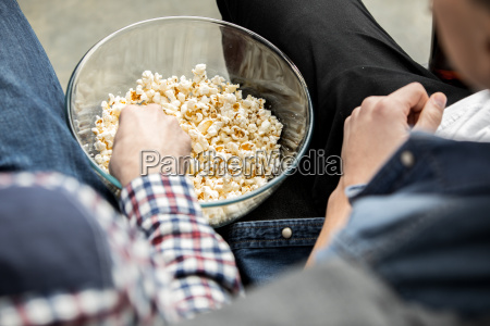 friends eating popcorn