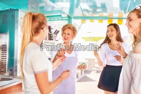 senior female business owner serving ice