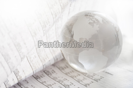 financial newspaper with crystal ball