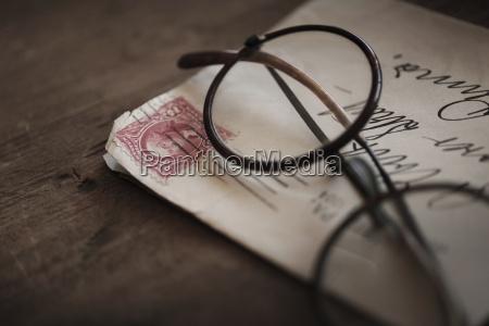 antique eyeglasses with envelope