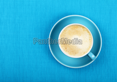 full cappuccino latte coffee in blue