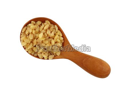 yellow bulgur big grains in wooden