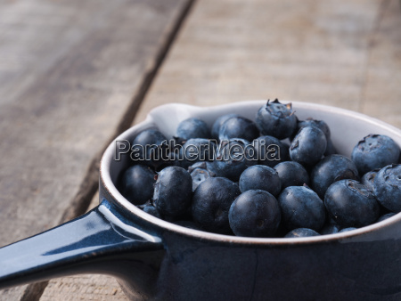 organic blueberries in a rustic bowl