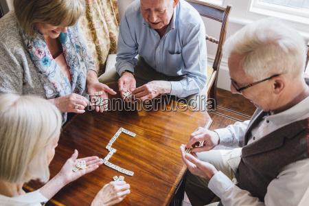 senior friends playing dominoes