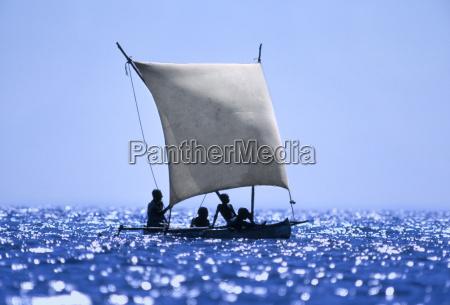 vezo fishermen sailing in outrigger canoe