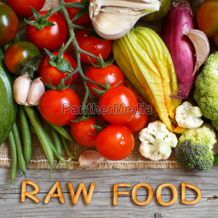 fresh vegetables and wooden letters raw